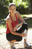Young Woman Resting Drinking Water After Run Stock Image