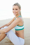 Young Woman Resting After Exercise On Beach Stock Image