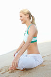 Young Woman Resting After Exercise On Beach Royalty Free Stock Images