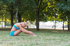 Young woman  resting between exercises in the park Royalty Free Stock Photos