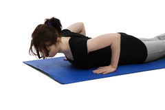 Young woman resting while exercising Stock Photo