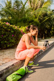 Young woman resting after exercising and holding water bottle Royalty Free Stock Photography