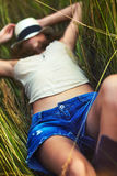 Young woman resting on grass Royalty Free Stock Image