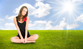 Young woman resting on a grass Stock Images