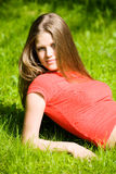Young woman resting on a grass Stock Photo