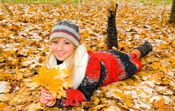 Young woman resting on the ground Royalty Free Stock Photography