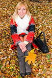 Young woman resting on the ground Stock Photos