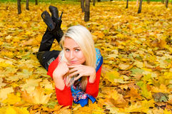 Young woman resting on the ground Royalty Free Stock Photo