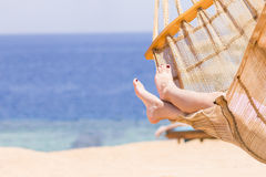 Young woman resting in hammock near the sea Royalty Free Stock Photography