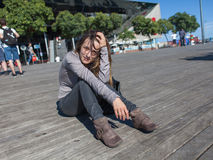 Young woman resting on harbor pier in Barcelona Stock Photography