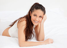 Young woman resting in her bed Stock Images