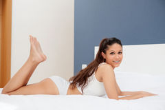 Young woman resting in her bed Royalty Free Stock Photos