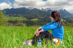 Young woman resting after hiking Stock Photo