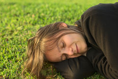 Young Woman Resting on Lawn Stock Photography