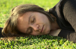 Young Woman Resting on Lawn Stock Photos