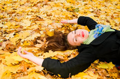 Young woman resting on the leaves Stock Photography