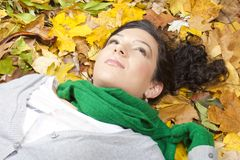 Young woman resting on leaves Royalty Free Stock Photo