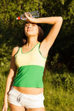 A young woman resting after a long run. A young woman athlete resting after a long run royalty free stock image