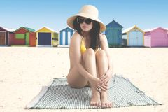 Young woman resting near the cottage Royalty Free Stock Photography