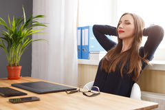 Young woman resting near window sitting in chair Royalty Free Stock Photo