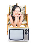 Young woman resting on old retro tv Royalty Free Stock Photo