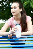 Young Woman Resting On Park Bench During Exercise Stock Images