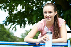 Young Woman Resting On Park Bench During Exercise Stock Photography