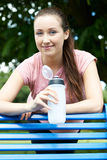 Young Woman Resting On Park Bench During Exercise Stock Photo