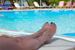 Young woman resting by the pool 1 Stock Photos