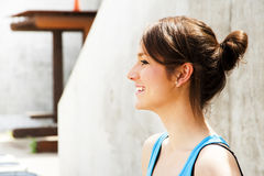 Young woman resting after run by the wall in city with big smile Royalty Free Stock Photography