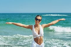 Young woman at a seaside resort stock images