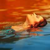 Young woman resting on the sea Royalty Free Stock Image