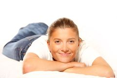 Young woman resting on a sofa Stock Images