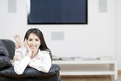 Young woman resting on sofa Royalty Free Stock Photography