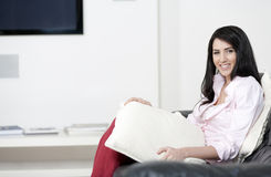 Young woman resting on sofa Royalty Free Stock Photo