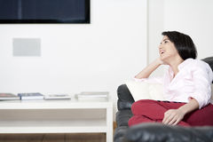 Young woman resting on sofa Royalty Free Stock Image