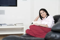 Young woman resting on sofa Stock Photo