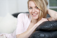 Young woman resting on sofa Stock Photography