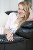 Young woman resting on sofa Royalty Free Stock Photos