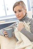 Young woman resting on sofa with tea Royalty Free Stock Photo