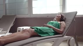 A young woman resting on a sun lounger in a Turkish bath. A young woman resting on a sun lounger in a Turkish bath stock video footage