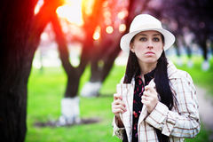 Young woman resting at sunset in the park Royalty Free Stock Images