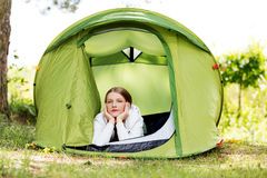 Young woman resting in a tent on the nature Stock Photos