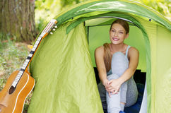 Young woman resting in a tent on the nature Stock Images