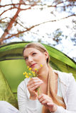 Young woman resting in a tent on the nature Stock Photo