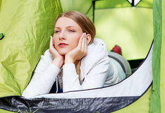 Young woman resting in a tent on the nature Royalty Free Stock Image