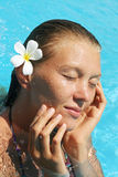 Young woman resting in water. Young woman with closed eyes relax on the water Royalty Free Stock Photography