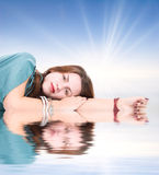 Young woman resting on a water surface Royalty Free Stock Photography