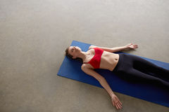 Young woman resting in zen position Royalty Free Stock Photos