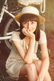 Young woman with retro bicycle in a park Royalty Free Stock Photos